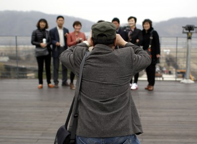 Chinese tourists take pictures at the Imjingak Pavilion in South Korea.