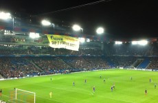 Greenpeace protesters abseil from stadium roof during Champions League match