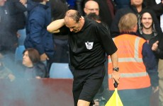 Linesman struck by flare thrown from the crowd at Villa Park