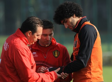 Belgium's head coach Marc Wilmots, team doctor Kris Van Crombrugge and Fellaini.