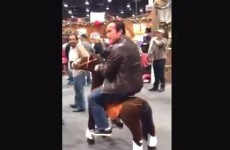 Oh, just Arnold Schwarzenegger riding around on a toy horse