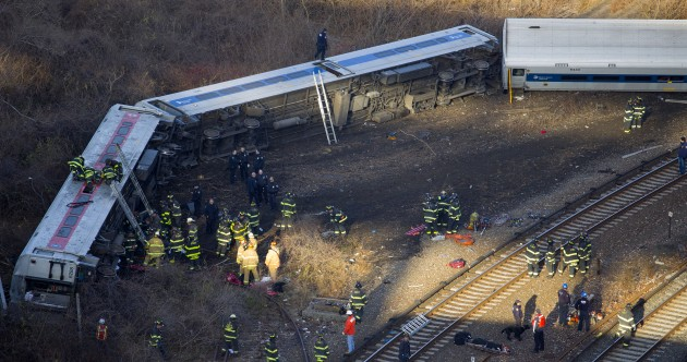 Pics: Four dead, 63 injured as passenger train derails in New York City